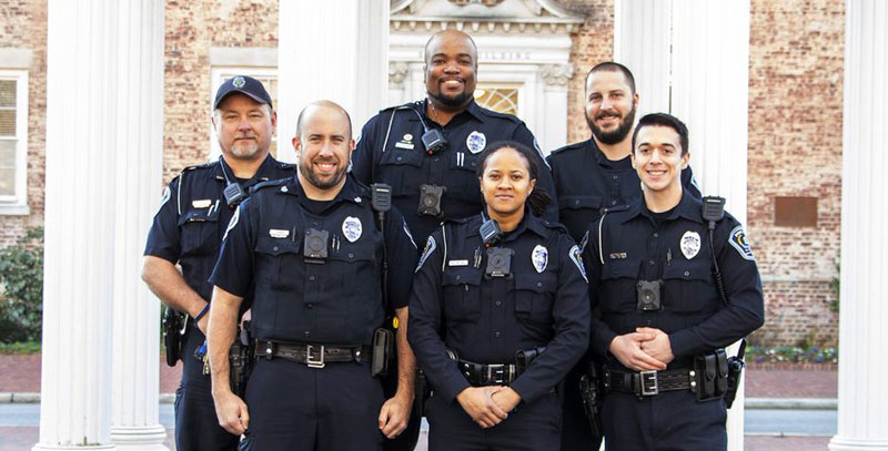 Group shot of UNC Police in front of South Building and the Well