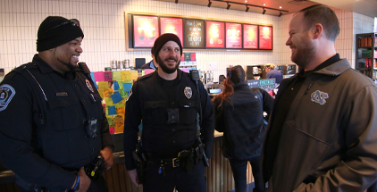 UNC Police officers attending the Coffee with a Cop event