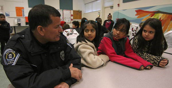 UNC Police officer speaking to local children during the annual Shop with a Cop event