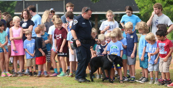 K9 Officer and partner attending an outreach event at a local school