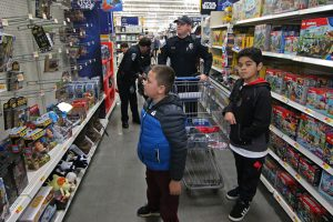 UNC Police officers shopping for Christmas gifts with two elementary school students